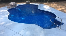 Freeform Pool & Spa with Rock Grotto and Concrete deck